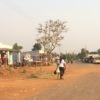Village outside Kisumu with Airtel mobile money transfer office at left. Photo by J. Mark Souther. All rights reserved.